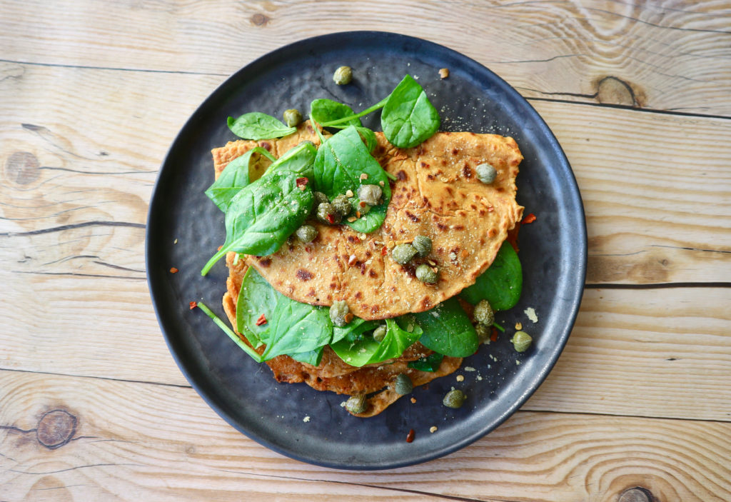 Sun-dried tomato chickpea pancakes with spinach
