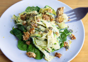 Creamy Courgettes with Sage, Capers and Smoky Tempeh on a Bed of Spinach